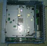 The top of the unit with the cover removed showing the CD drive.